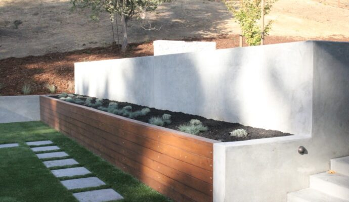Concrete-retaining-wall-We offer custom concrete solutions including Polished concrete, Stained concrete, Epoxy Floor, Sealed concrete, Stamped concrete, Concrete overlay, Concrete countertops, Concrete summer kitchens, Driveway repairs, Concrete pool water falls, and more.